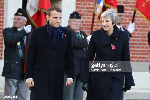 Prime Minister Theresa May and French President Emmanuel Macron attending a wreath laying ceremony at the Thiepval Memorial in Authuille France