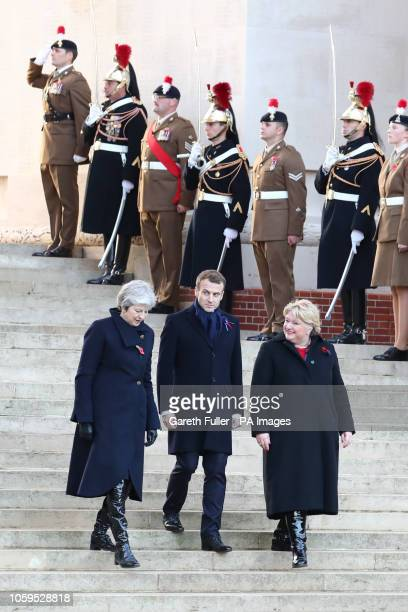 Prime Minister Theresa May and French President Emmanuel Macron attend a wreath laying ceremony at the Thiepval Memorial in Authuille France