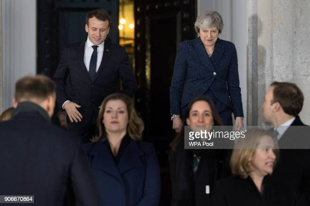 Prime Minister Theresa May and French President Emmanuel Macron attend a 'family photograph' at the Royal Military Academy Sandhurst on January 18...