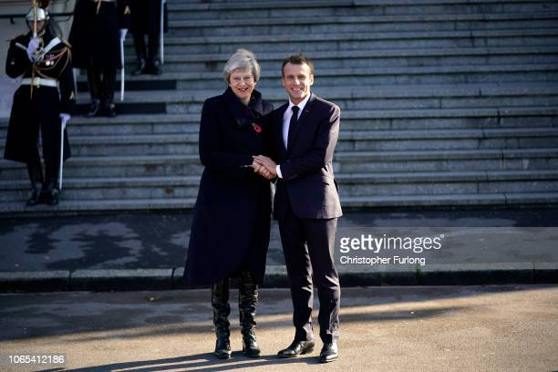 Prime Minister Theresa May and French President Emmanuel Macron shakes hands as they arrive on the steps of Albert Town Hall for a meeting in the...