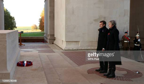 Prime Minister Theresa May and French President Emmanuel Macron lay a wreath during a ceremony at Thiepval Memorial on November 09, 2018 in Thiepval,...
