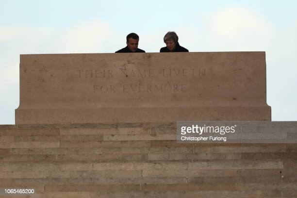 Prime Minister Theresa May and French President Emmanuel Macron meet after a wreathlaying ceremony at Thiepval Memorial on November 09 2018 in...