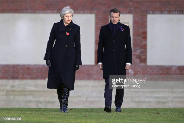 Prime Minister Theresa May and French President Emmanuel Macron meet after a wreath-laying ceremony at Thiepval Memorial on November 09, 2018 in...