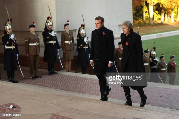 Prime Minister Theresa May and French President Emmanuel Macron prepare to lay a wreath during a ceremony at Thiepval Memorial on November 09, 2018...