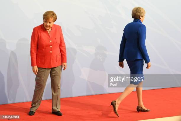 Prime Minister Theresa May and German Chancellor Angela Merkel attend the G20 summit on July 7 2017 in Hamburg Germany Leaders of the G20 group of...