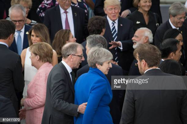 Prime Minister Theresa May and her husband Philip as G20 leaders and their spouses arrive to attend a concert at the Elbphilharmonie concert on the...