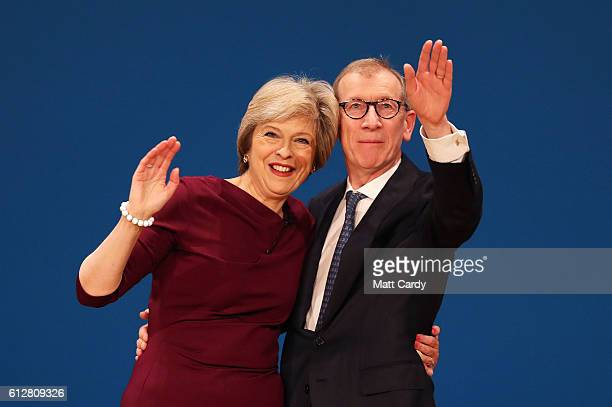 Prime Minister Theresa May and her Husband Philip John embrace after she delivers a speech during the fourth day of the Conservative Party Conference...