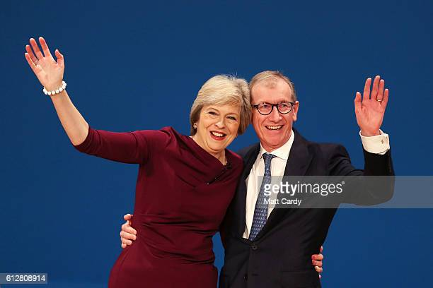 Prime Minister Theresa May and her Husband Philip John react after she delivers a speech during the fourth day of the Conservative Party Conference...