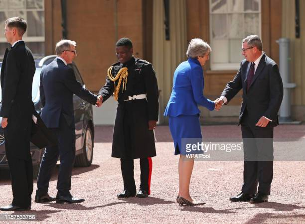 Prime Minister Theresa May and her husband Philip May are greeted by Rt Hon Edward Young private secretary to the Queen and Major Nana TwumasiAnkrah...
