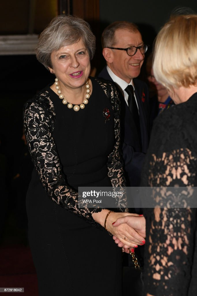 Prime Minister Theresa May and her husband Philip May arrive at the annual Royal Festival of Remembrance to commemorate all those who have lost their lives in conflicts at the Royal Albert Hall on November 11, 2017 in London, England.