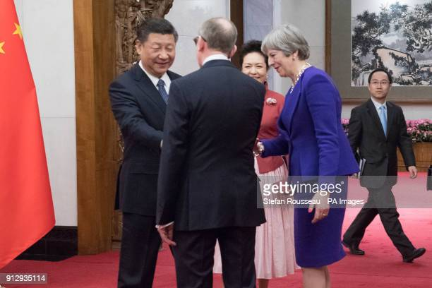 Prime Minister Theresa May and her husband Philip meet Chinese President Xi Jinping and his wife Peng Liyuan at the Diaoyutai State Guest House in...