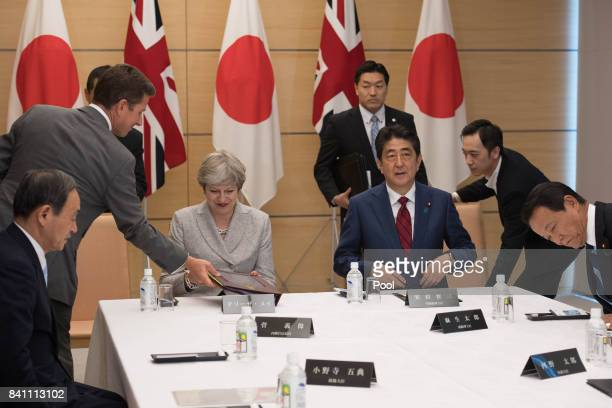Prime Minister Theresa May and her Japanese counterpart Shinzo Abe meet with Japan's National Security Council at the Prime Minister's office in...