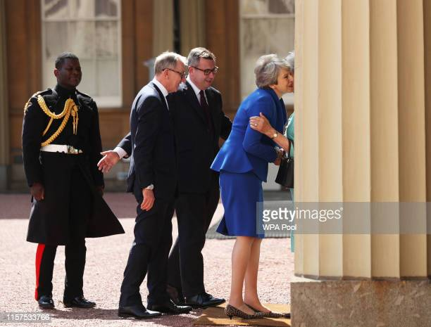 Prime Minister Theresa May and husband Philip May are greeted by Rt Hon Edward Young private secretary to the Queen Major Nana TwumasiAnkrah...