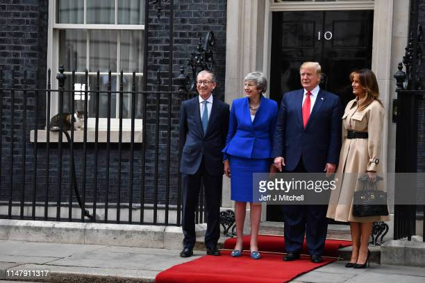 Prime Minister Theresa May and husband Philip May welcome US President Donald Trump and First Lady Melania Trump to 10 Downing Street as Larry the...