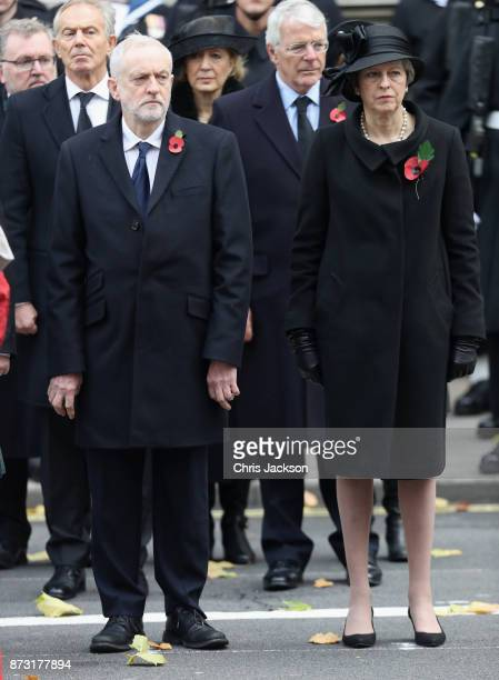 Prime Minister Theresa May and Labour leader Jeremy Corbyn during the annual Remembrance Sunday memorial on November 12 2017 in London England The...