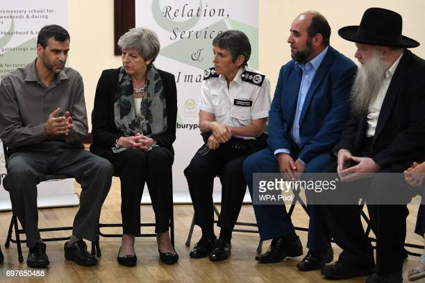Prime Minister Theresa May and Metropolitan Police Commissioner Cressida Dick talk to faith leaders including Mohammed Kozbar a chair of the mosque...
