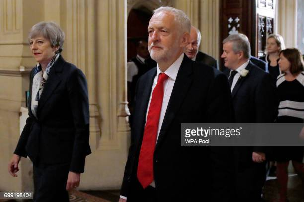 Prime Minister Theresa May and opposition Labour Party leader Jeremy Corbyn walk through the Peers Lobby in the Houses of Parliament during the State...