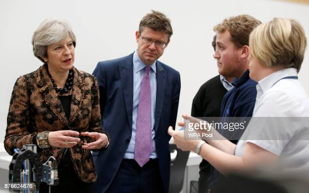 Prime Minister Theresa May and Secretary of State for Business Greg Clark visit an engineering training facility on November 20 2017 in Birmingham...