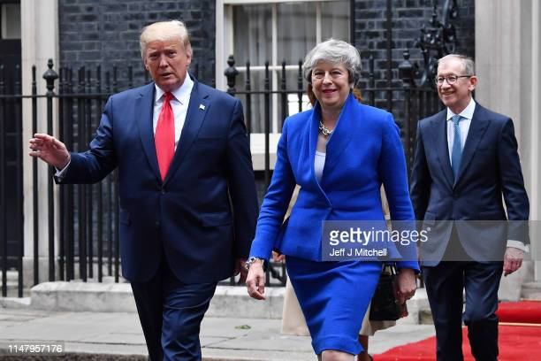 Prime Minister Theresa May and US President Donald Trump leave 10 Downing Street during the second day of his State Visit on June 4 2019 in London...