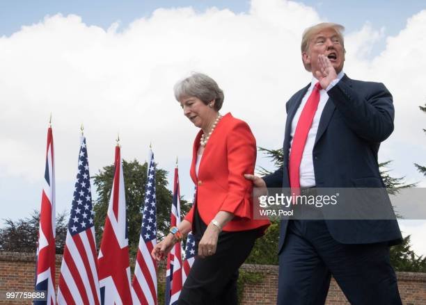 Prime Minister Theresa May and U.S. President Donald Trump make their way to a joint press conference following their meeting at Chequers on July 13,...