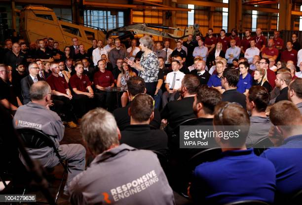 Prime Minister Theresa May answers questions during a QA session with employees at the Armstrong Works engineering facility which is part of the...