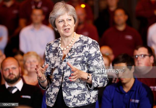 British Prime Minister Theresa May answers questions during a QA session with employees at the Armstrong Works engineering facility which is part of...