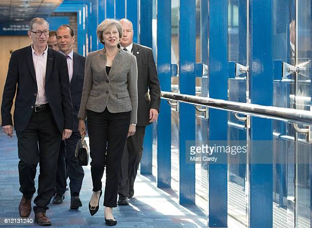 Prime Minister Theresa May arrives to listen to the Chancellor of the Exchequer Philip Hammond as he delivers a speech on the economy during the...