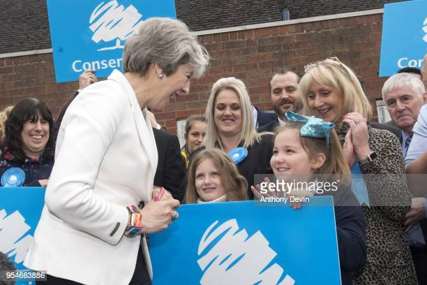 Prime Minister Theresa May comments on the hair bow worn by 8yearold Olivia Bennett as she speaks to party supporters at Sedgley Conservative Club on...