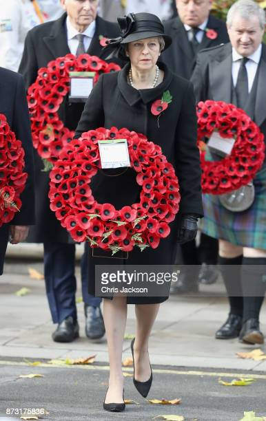 Prime Minister Theresa May during the annual Remembrance Sunday memorial on November 12 2017 in London England The Prince of Wales senior politicians...