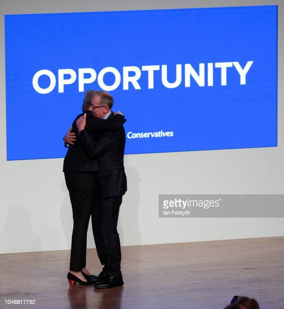 Prime Minister Theresa May embraces her husband Philip May after she delivered her keynote speech on the final day of the Conservative Party...