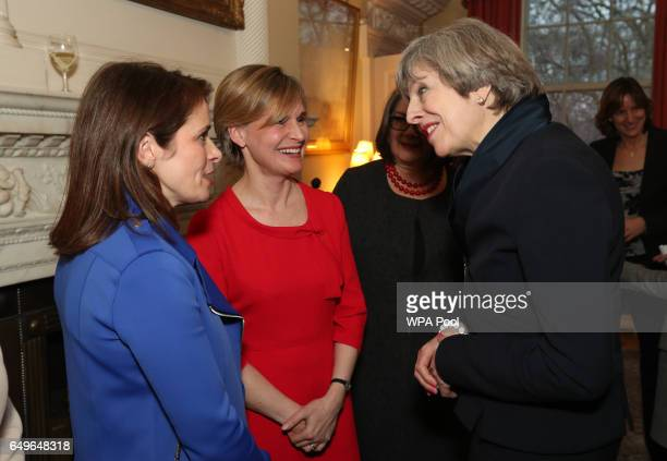 Prime Minister Theresa May greets Dr Laura Young and Justine Mitchell during an International Women's Day reception at 10 Downing Street on March 8...