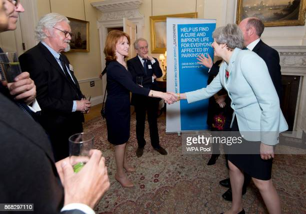 Prime Minister Theresa May greets Jane Asher during a reception to mark 200 years since Dr James Parkinson published 'An Essay on the Shaking Palsy'...
