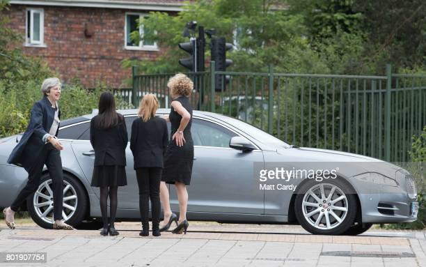 Prime Minister Theresa May greets pupils Miya Herbert Katie Davies and head teacher Dr Helen Holman as she arrives for a session for teachers...