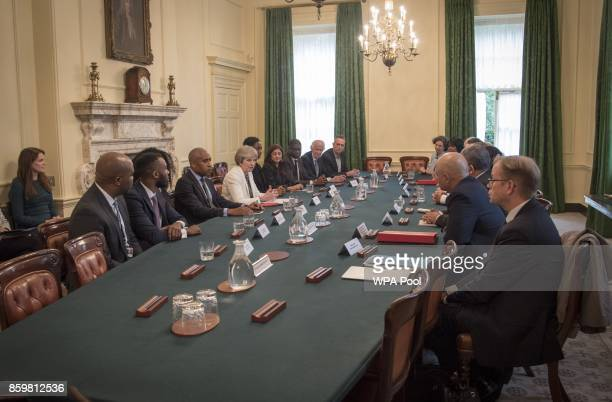Prime Minister Theresa May hosts a discussion around the Cabinet table on the findings of the Race Disparity Audit at 10 Downing Street on October 10...