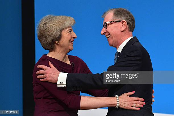 Prime Minister Theresa May hugs her husband Philip after delivering her speech during the fourth day of the Conservative Party Conference 2016 at the...