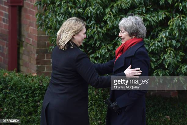 Prime Minister Theresa May is greeted by Northern Ireland Secretary of State Karen Bradley as she arrives at Stormont House on February 12 2018 in...