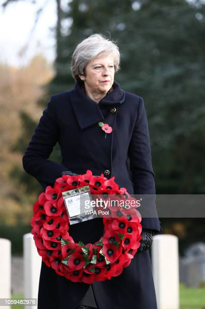 Prime Minister Theresa May lays a wreath at the graves of John Parr the first British soldier to be killed in 1914 and George Ellison the last to be...