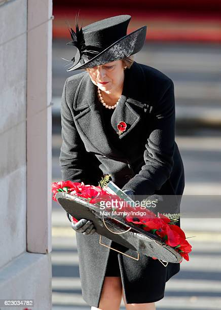 Prime Minister Theresa May lays her wreath as she attends the annual Remembrance Sunday Service at the Cenotaph on Whitehall on November 13 2016 in...