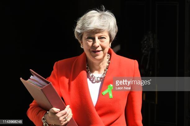 Prime Minister Theresa May leaves 10 Downing Street for Prime Minister's Questions on May 15, 2019 in London, England.