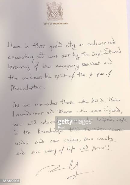 Prime Minister Theresa May leaves a message to the people of Manchester at Manchester Town Hall on May 23 2017 in Manchester England A 23yearold man...