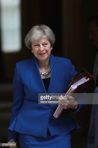 Prime Minister Theresa May leaves Downing Street ahead of Prime Minister's Questions on June 20 2018 in London England MPs vote today on the...