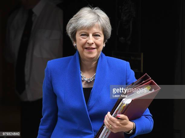 Britain's Prime Minister Theresa May leaves Downing Street ahead of Prime Minister's Questions on June 20 2018 in London England MPs vote today on...