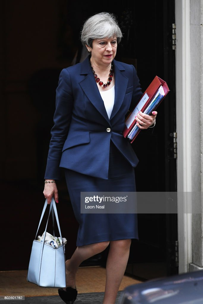 Prime Minister Theresa May leaves Downing Street on her way to attending Prime Minister's Questions in the Houses of Parliament on June 28, 2017 in London, England. Today marks the first session of Prime Minister's Questions since the Conservatives lost their majority in the recent General Election.