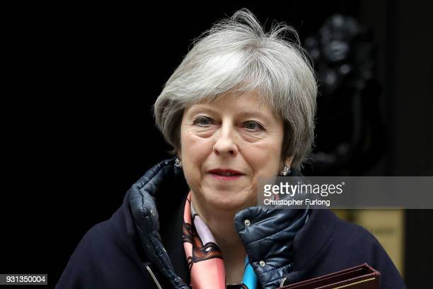 Prime Minister Theresa May leaves Downing Street to listen to Chancellor Philip Hammond present the Spring Statement in Parliament on March 13 2018...