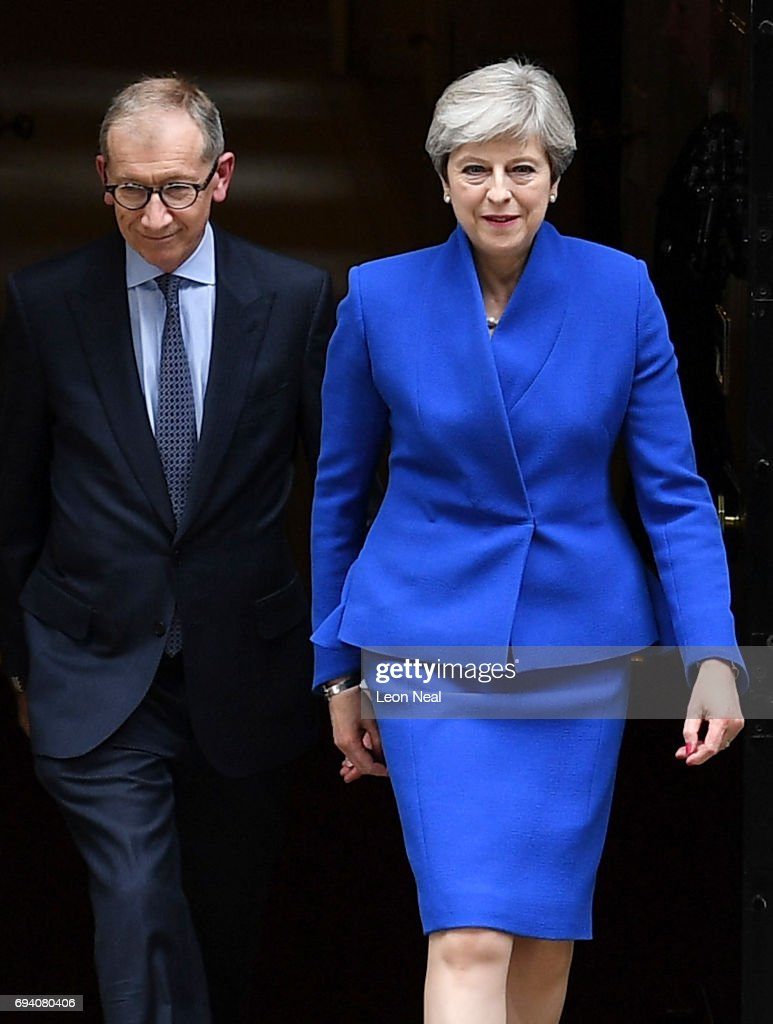 Prime Minister Theresa May leaves Downing Street with her husband Philip to go to Buckingham Palace where she will seek the Queen's permission to form a UK government on June 9, 2017 in London, England. After a snap election was called by Prime Minister Theresa May the United Kingdom went to the polls yesterday. The closely fought election has failed to return a clear overall majority winner and a hung parliament has been declared.