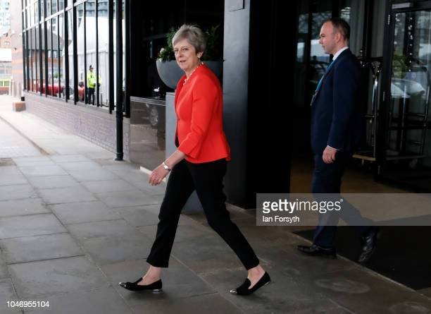 Prime Minister Theresa May leaves the Hyatt Regency Hotel for an interview with Andrew Marr on day one of the Conservative Party Conference on...