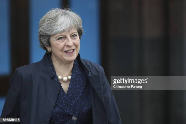 Prime Minister Theresa May leaves the Midland Hotel at the start of day two of the Conservative Party Conference on October 2 2017 in Manchester...