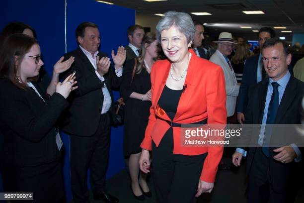 Prime Minister Theresa May leaves the Welsh Conservative party conference with Alun Cairns MP at Ffos Las Racecourse on May 18 in Kidwelly Llanelli...