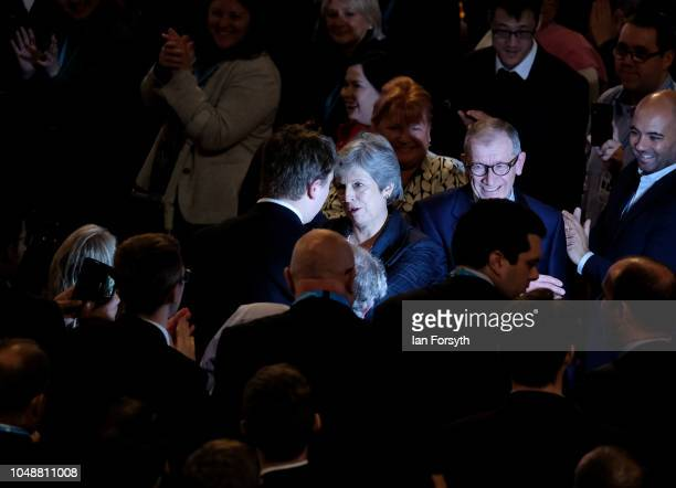 Prime Minister Theresa May makes her way through the crowd after she delivers her keynote speech on the final day of the Conservative Party...