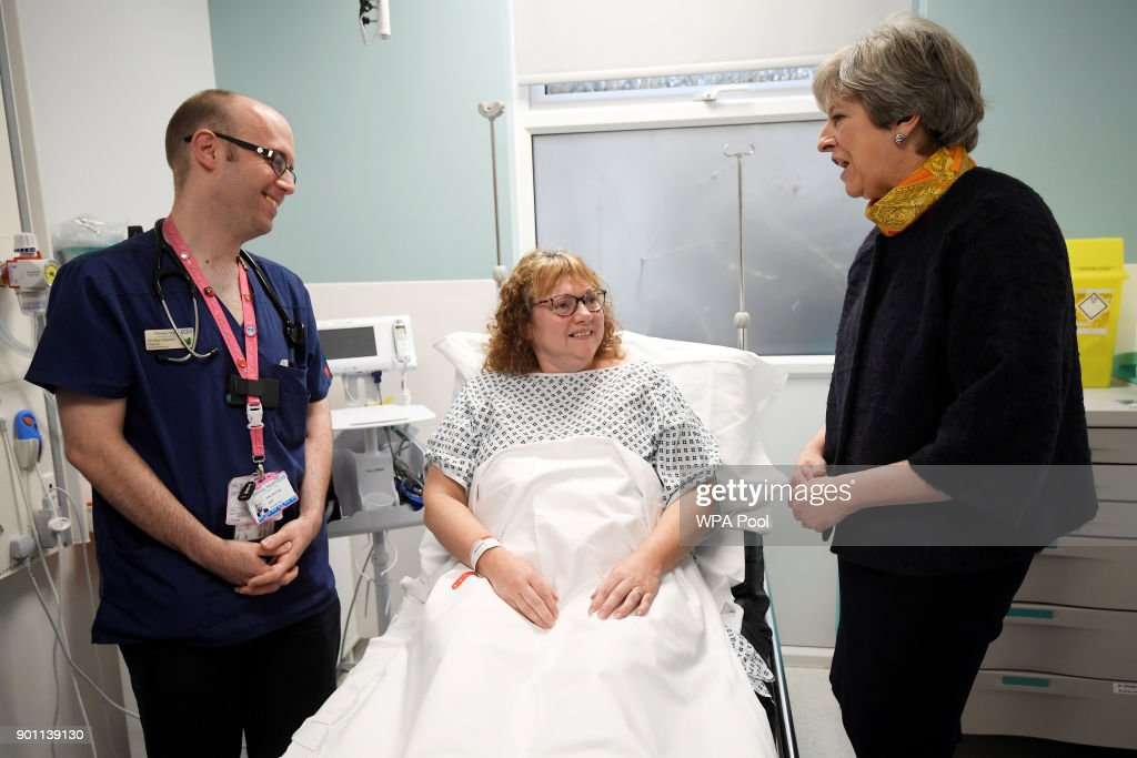 Prime Minister Theresa May meets patient Sandra Dunn at Frimley Park Hospital on January 4, 2018 in Frimley, England.